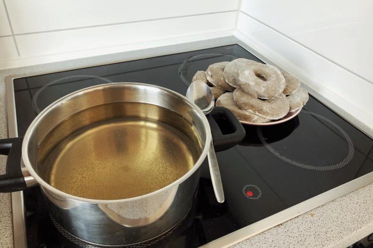 Preparing hot sugar water for bagels
